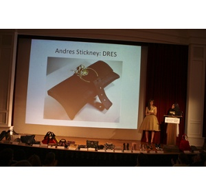 Christina Polychroni of Korres Natural Products presenting the Winner of the Best Green Handbag, Andres Stickney for DRES