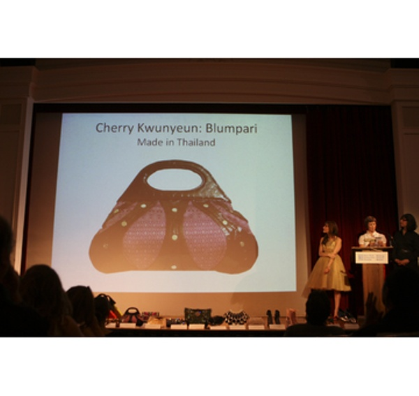 Presenter Kendall Farrell announcing the winner of the Most Socially Responsible Handbag, Cherry Kwunyeun of Blumpari.