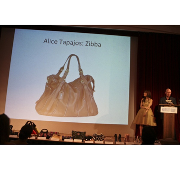 Presenter Lincoln Moore of Saks Fifth Avenue announcing the Winner of the Best Handbag in Overall Style and Design, Alice Tapajos for Zibba.